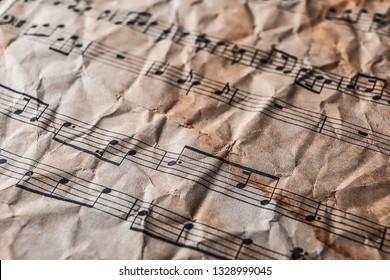 Old crumpled music sheet, closeup