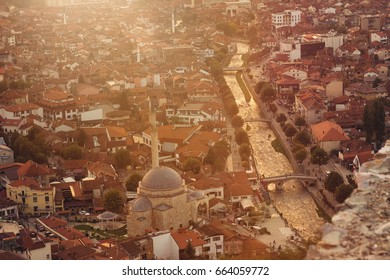 old and cultural city of Prizren, Kosovo with the golden river in the evening sunshine