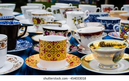 old cups at flea market. porcelain china mugs. tea set. shopping vintage retro old.
