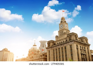 Old Customs Building with Clock and Flag, The Bund, Shanghai, China. The Customs Building was built in 1927.