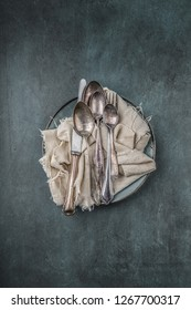 old cutlery, different kinds, on a cloth, top view