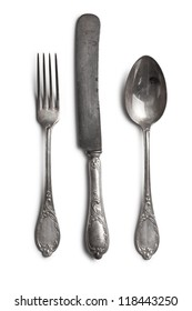 old cutlery on white background