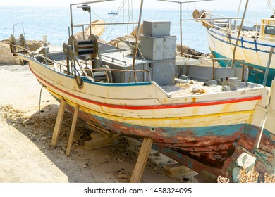 Old Cutter in the Harbor of Hersonissos, Crete, Greece