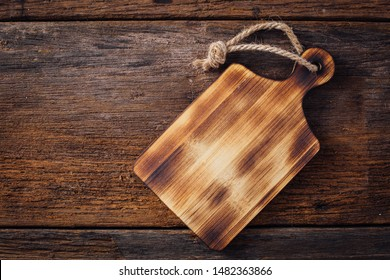 old cutting broad on wooden background