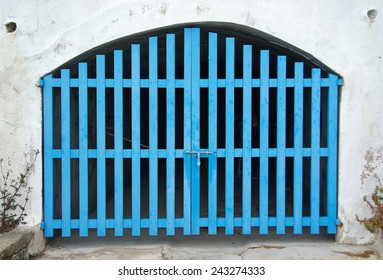 Old Cyan Wooden Door of a boat shelter in the Mediterranean Sea (Majorca)