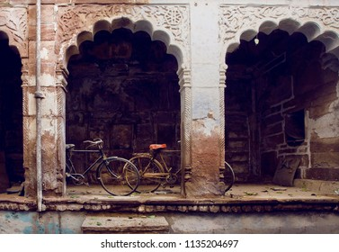Old cycles in courtyard of historical indian house. India leisure consept