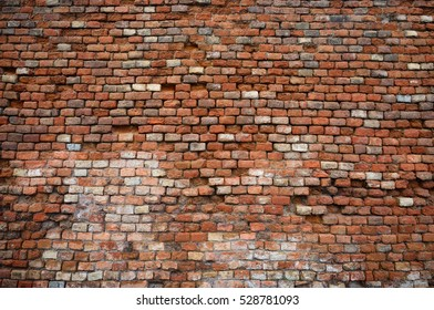 Old and damaged brick wall texture background
