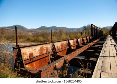 Old damaged bridge in the mountains.