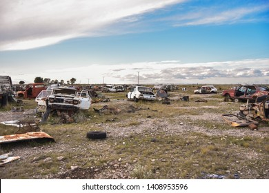 Old damaged cars on the junkyard waiting. Cemetery of cars.