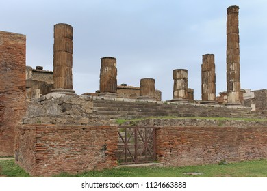 Old damaged columns in ancient city of Pompeii