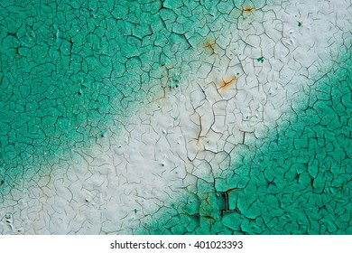 Old damaged cracked colored metal surface