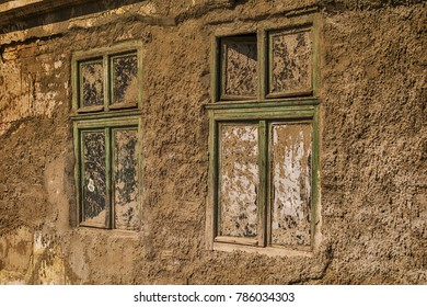 Old damaged house and dirty windows