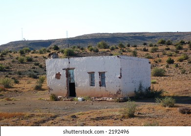 Old damaged house in a semi-desert of africa