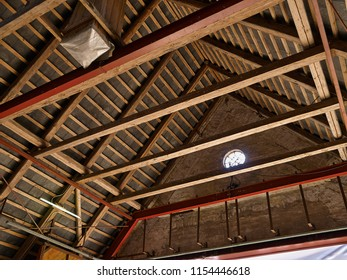 Old damaged roof ceiling of a vintage farm house