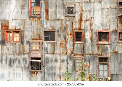 Old and damaged rustic wall and windows in UNESCO World Heritage city of Valparaiso, Chile
