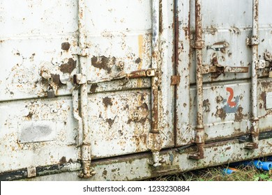 Old damaged rusty shipping container locking system,