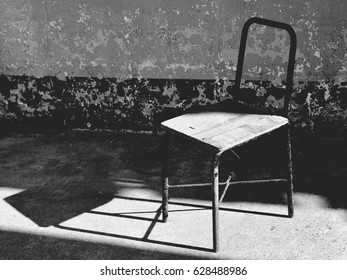 old and damaged steel chair in rural school - vintage style