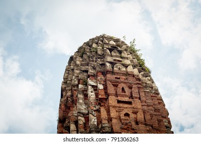 Old damaged Stupa or Temple at Ayutthaya Historical park in Thailand
