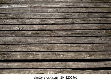 Old, damaged, wet deck boards.