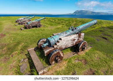 Old Danish cannons in Skansin fortress of Torshavn,  Faroese island of Streymoy. Nolsoy island is at background
