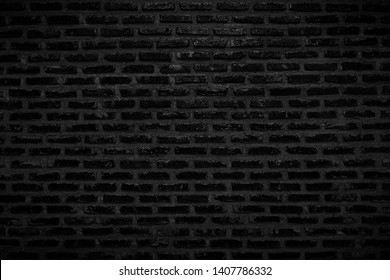 Old dark black brick wall texture for background and wallpaper decoration