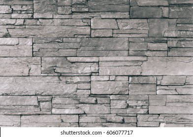 Old Dark grey seamlessly stone brick wall background - texture pattern for continuous replicate.