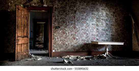An old dark mysterious room. Scary scene from a haunted house. Decaying walls and floor sat rotting for years.