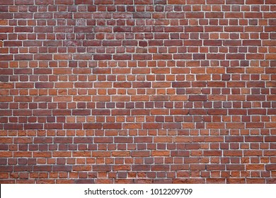 Old Dark Red Brown Tone Brick Wall Texture. Strong Brickwork Seamless Surface. Shabby Building Facade Background. Perfect Stonework Backdrop. Stonewall Surface For Design