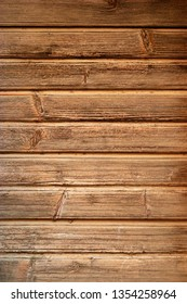 Old Dark rough wood floor or surface with splinters and knots. Brown oak wood texture. background old panels
