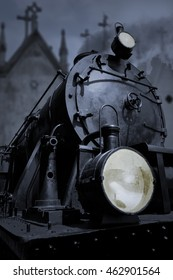 Old dark steam train in a cemetery station. Conceptual image about fear, life, death, old flaccid Europe and Caronte.