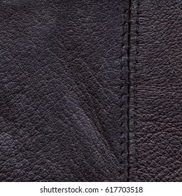 old dark violet leather background decorated with a seam