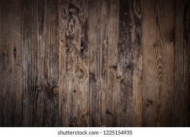 Old dark wooden wall, detailed background photo texture. Wood plank fence close up.