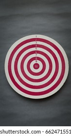 Old dart board on grey paper background
