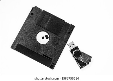 OLD DATA FLOPPY DISK AND SMALL FLAT DRIVE FOR COMPUTER , ISOLATED WHITE BACKGROUND