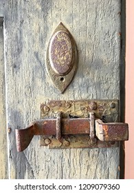 old deadbolt on wooden door