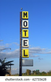 Old decayingmotel sign along the famous Route 66