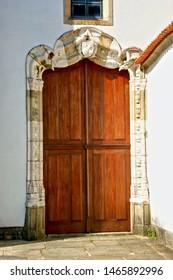 Old decorated door in Vila do Conde, Portugal