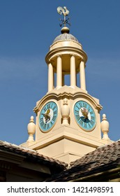 Old Decorative Clock Tower with a Rooster Weather vane on top.