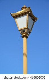 Old decorative lamp against the sky