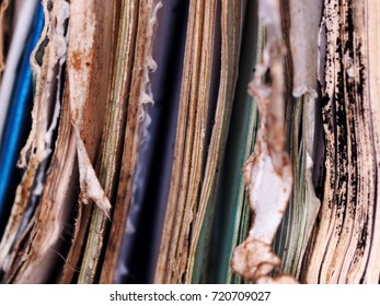 old defect books paper sheets and documents destroyed after hi level flood in the city authentic real object crop closeup dark background