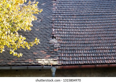 Old defective roof of an apartment building