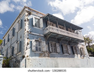 Old delapidated house in the old town of Charlotte Amalie St Thomas USVI with ornate balcony
