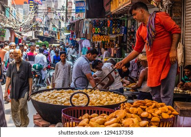 Old Delhi, India - August 21, 2018: A  person cooking snacks on the streets of old Delhi in India.
