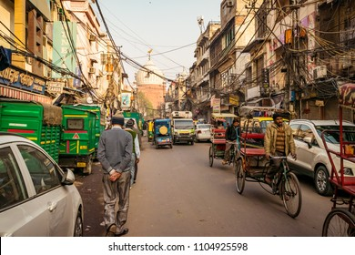 OLD DELHI, INDIA - January 2018: Chaotic traffic in Chandni Chowk market, Street with people and traffic at historical part of old Delhi area, India.