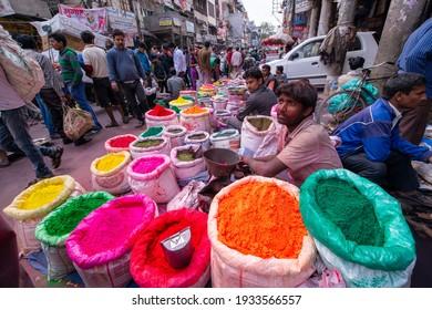 Old Delhi, Delhi, India, march 11 2014: Indian Salesman in his street shop selling colorful powder for Holi Festival, bussy market of sadar bazaar.