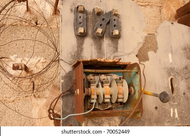 Old derelict electric circuit breaker on a grunge wall