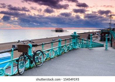 The old derelict West Pier in Brighton at sunset from the roadside.