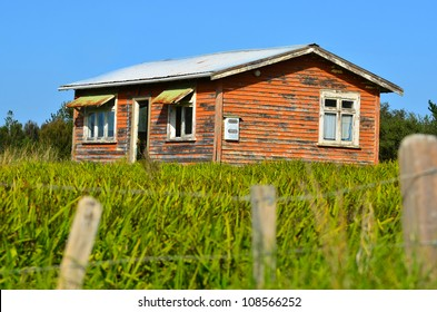 Old deserted wooden farm house.