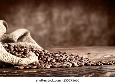 old desk of coffee beans and sack