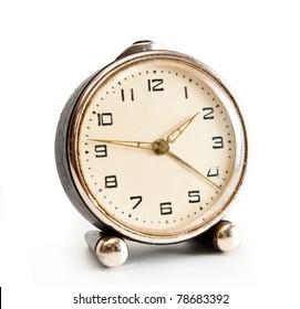 old desktop alarm clock isolated on white background